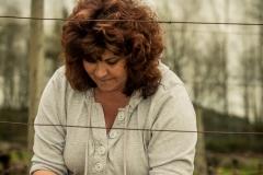 Tina Tying Vines in Vineyard